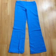 Lululemon wide leg pants! Miami blue wide leg pants! Made with Lululemon's special wicking fabric. There's some slight pilling along the inner thighs. These are super stunning and really fun for dance class, yoga, Zumba, etc. lululemon athletica Pants Track Pants & Joggers