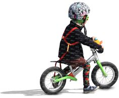 child wearing a helmet riding a likebike - cut out people - VIShopper