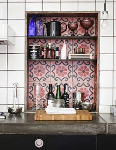 Open cabinet with colorful tiles. Love this for a coffee station or a bar area... tiles behind shelf?