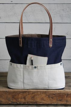 We're so excited to release the first Folk Fibers X Forestbound collaborative tote bag! These limited edition tote bags are made from soft, sturdy linen & bamboo canvas that was hand dyed with natural Sacs Tote Bags, Canvas Tote Bags, My Bags, Purses And Bags, Jean Purses, Denim Purse, Linen Bag, Handmade Bags, Handmade Leather