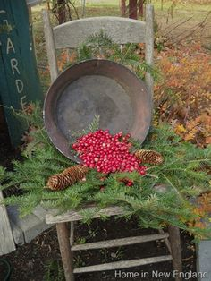 Weathered Garden Chair...with old metal pan, pines, berries, & cones.