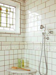 This remodeled master bath features a stained-glass window that was removed from an original service hallway in another part of the home. The window offers privacy while filling the shower with light and a renewed Victorian spirit. White Bathroom Tiles, Bathroom Windows, Glass Bathroom, Glass Shower, Bathroom Ideas, Bath Ideas, Hall Bathroom, Modern Bathroom, Master Bathroom