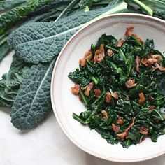 Wilted Kale and Bacon Salad HealthyAperture.com. I have used this w onion in pasta and my picky husband ate it... So I may try this as a side dish for turkey day-