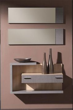 Dé la bienvenida a sus visitas con este magnífico recibidor en un atractivo estilo moderno y contemporáneo, que se compone de un mueble con cajón de diseño minimalista y un original espejo en dos piezas. Disponible en dos combinaciones de colores: ceniza/xacobeo y wengué/xacobeo.: