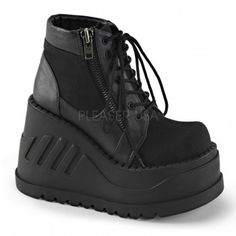 Stomp Zippered Womens Platform Sneaker - New at ShoeOodles.com Price: $84.95  Womans platform sneaker has a 4 3/4 inch platform heel with exposed side zipper and padded ankle.  Eco-friendly all man made materials with padded insole and non-skid sole.  #gothic #fashion #steampunk