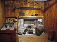The early-1800s kitchen at the Culinary Arts Museum at Johnson & Wales University in Providence includes an open hearth for cooking with wood and a dry sink, a cabinet with a recessed top for water pitcher and basin. A reflector oven is also on display – basically a hand-turned rotisserie that is placed in front of a fire.