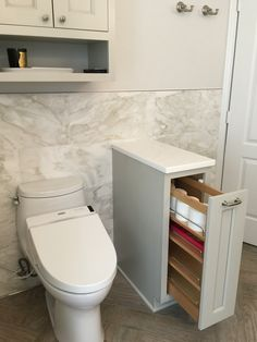 Privacy wall with storage. Cabinets painted with SW Repose Grey by Shiloh Cabinets. Toto toilet. Walls SW Eider White.