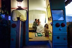 Romantic candid of the bride and groom kssing and having some time for to focus on each other in a remodeled old bus after their wedding at Taber Ranch Vineyard