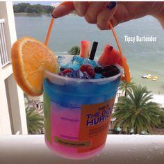 CARIBBEAN STORM Bottom Layer: 1 oz. (30ml) Triple Sec  1 oz. (30ml) Mango Tequila 1 oz. (30ml) Pineapple Rum 2 oz. (60ml) Banana Rum 6 oz. (180ml) Calypso Triple Melon Lemonade Top Layer:  2 oz. (60ml) Mango Vodka 1 oz. (30ml) Blue Curacao