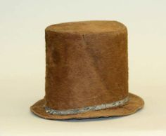 Top hat    Date:      ca. 1830  Culture:      American  Medium:      silk  Dimensions:      Height (of crown): 7 1/4 in. (18.4 cm)  Credit Line:      Purchase, Gifts in memory of Elizabeth N. Lawrence, 1983  Accession Number:      1983.6.2