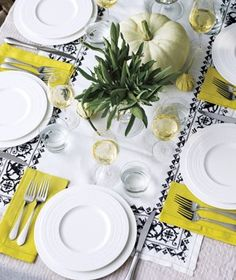 Modern Thanksgiving Tablescape — Real Simple jazzed things up with a touch of color. The white and black table coverings are a perfect canvas for the chartreuse napkins. Thanksgiving Table Settings, Thanksgiving Tablescapes, Thanksgiving Decorations, Table Decorations, Centerpieces, White Dishes, White Plates, Beautiful Table Settings, Mellow Yellow