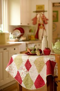 1950's Summer Tablecloth  ....there is something so sweet about using a quilt for a tablecloth :)