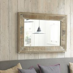 FLOTSAM MIRROR. The reclaimed wood in this beautiful mirror once had a wonderful life as somebody's front door. So perhaps its next life could be spent with you looking at it in your lovely home?