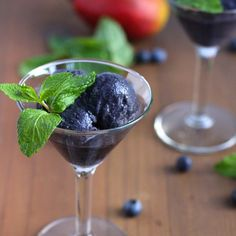 Easy blueberry, mango, mint sorbet. Only frozen fruit, coconut milk and mint blended together and chilled. Low-calorie and no added sugar!