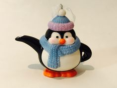 Hallmark Tracy Larsen Tea Time Penguin Teapot Christmas tree ornament ... in shape of penguin in winter scarf and toque, second in series of five that will feature a teapot and teacup in classic shapes and Christmas designs, Keepsake Ornament dated 2017, porcelain, USA