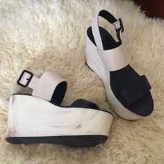 """Faux Wood BCBGeneration Platform Wedges Slides BCBGeneration Wedges. Very Isabel Marant /Marni inspired.  It's hard to tell in the picture but the brown marks are part of the """"faux wood """" of the shoe. The black dots near the heel are dirt/stains. BCBGeneration Shoes Platforms"""