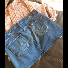 """7 For all Mankind Denim Mini Skirt Size 30. Medium blue denim color. In excellent condition. Super soft worn-in look. Was purchased exactly like this. The length in front from waist to hem is 13"""" and in back is 14"""". When laid flat the waist measures 17"""" for a total around of 34"""". 7 for all Mankind Skirts Mini"""