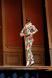 Harlequin at the Pantomime Theatre in Tivoli Gardens in Copenhagen, Denmark Types Of Clowns, Tivoli Gardens Copenhagen, Harlequin Costume, Comedy Pictures, Jester Costume, Pierrot, Circus Wedding, Pantomime, Theatre Design