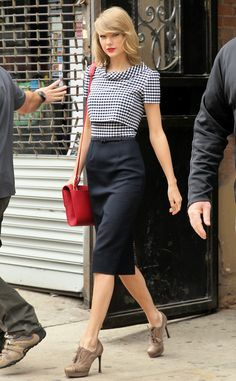 Taylor Swift keeps it classic in black and white with a pop of red.