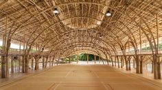 Chiangmai Life Architects and Construction modelled the segmented roof of this bamboo sports hall at a school in Thailand on the petals of a lotus flower.