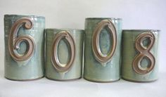 stoneware house number planters. Uh oh @Beth Barrett you will need to do these now too!
