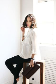 Open Button Collar Loose Cut Blouse in White, black slim cut pants and black clutch.