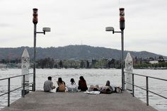 People down at the Zurich lake, Switzerland. Cn Tower, Switzerland, Building, People, Travel, Viajes, Buildings, Destinations, Traveling