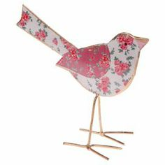 A charming addition to your home, this metal accent features a bird silhouette in floral tones. Team with bare woods, neutral fabrics and a sunny palette for an elegant country look.   Product: Bird accent Construction Material: MetalColour: Pink and multiDimensions: 12 cm H x 9 cm W x 6 cm D