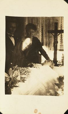 Taken by William Hope. In 1905 he became supposedly captured the image of a ghost while photographing a friend. He went on to found the Crewe Circle – a group of 6 spirit photographers. After World War I grieving relatives of those lost to the war sought a means of contacting their loved ones. Hope moved to London and became a professional medium. He was substituting glass plates bearing ghostly images in order to produce his spirit photographs.