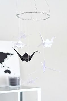I want to do this for our bedroom. I think it will looks nice above or bed. - paper crane mobile origami