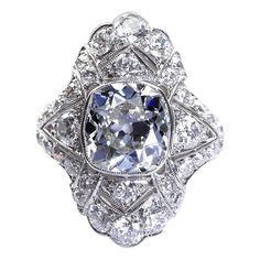 Art Deco 4.60 Carat Old Cushion Cut Diamond Platinum Ring   From a unique collection of vintage engagement rings at https://www.1stdibs.com/jewelry/rings/engagement-rings/