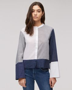 A contemporary take on the artist's shirt, this design has been skilfully constructed from contrasting sections. With pieces sourced from the Albini mill in northern Italy, known for shirting excellence, features include a grandad collar, full button placket and wide, long sleeves. Dress up with mules or down with loose-fitted jeans.