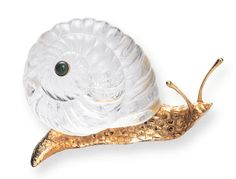A ROCK CRYSTAL AND GOLD SNAIL, BY BOUCHERON  The carved rock crystal shell enhanced by a cabochon chrysoprase, enhanced by a sculpted and textured 18K gold body, circa 1980