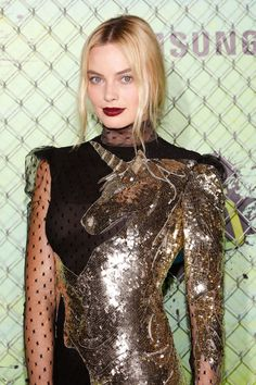 A close up of Margot Robbie's masterful, shimmery unicorn beaded Alexander McQueen dress, which she wore to the Suicide Squad premiere in New York City.