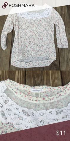 Love on a hanger floral top Worn once. Cute floral top. 3/4 length sleeves. love on a hanger Tops Tees - Long Sleeve