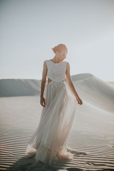 Dreamy Desert Wedding Inspiration by Thunder & Love | SouthBound Bride | Photography: Thunder & Love Wedding Photography | Styling, co-ordination, floral & decor: Happinest Weddings | Stationery: Oh Yay | Bride's dress: Brit & Bride | Hair & makeup: Makeup by Almari | Model: Martina Nicoletti of 3D Model Management | crocheted top boho inspired wedding gown