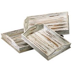 Accent a coastal or country cottage decor with the casual look of this set of three distressed white finish wood trays.