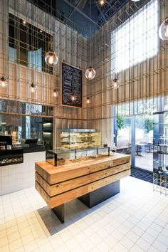 Bakery and wine shop interior design brass grid structure cages patisserie in by home improvement thrift . bakery and wine shop interior design Wine Shop Interior, Retail Interior, Cafe Interior, Shop Interior Design, Retail Design, Design Interiors, Bakery Design, Cafe Design, Restaurant Design