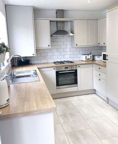 32 ideas for the small kitchen. Modern kitchen with a narrow design and wooden worktop. Page 30 of 32 – White N Black Kitchen Cabinets Home Decor Kitchen, Kitchen Interior, Kitchen Dining, Kitchen Cabinets, Kitchen Wood, Floors Kitchen, White Kitchen Floor Tiles, Kitchen Backsplash, Happy Kitchen