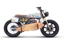 CLR125 city scrambler, hand-lettered paint-job, skateboard holder. Custom motorbike