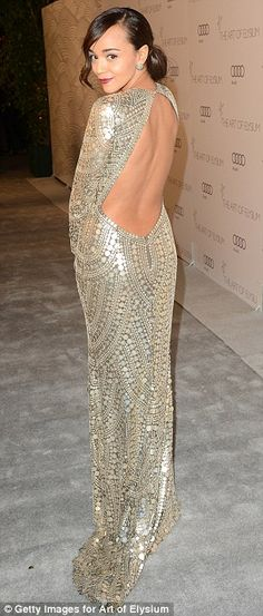 Going for gold: Revenge star Ashley Madekwe wowed in her backless gold beaded dress for the occasion