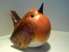 wood sculpture of  robin red breast by John Mainwaring