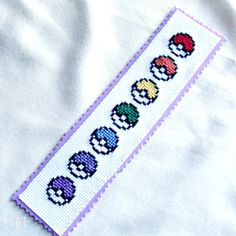 http://www.etsy.com/listing/97150077/pokemon-pokeballs-bookmark-cross-stitch?ref=sr_gallery_7_search_query=cross+stitch+bookmarks_view_type=gallery_ship_to=KW_explicit_scope=1_page=10_search_type=handmade