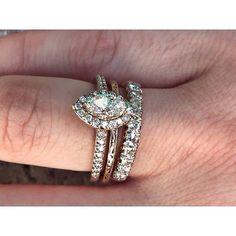 What are your thoughts of mixing modern with antique? Featured is our Modern Marquise Diamond Halo Engagement Ring with a total weight of 0.82cts. Below are two antique bands, middle etched in yellow gold, and bottom a diamond band with total weight of .40ct. We love this look! #engagement #antique #artdeco #wedding