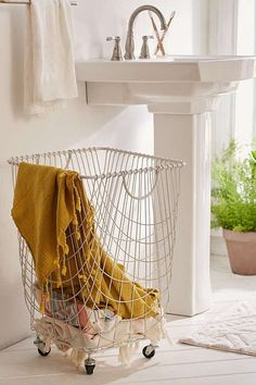 Shop Tike Wire Rolling Hamper at Urban Outfitters today. We carry all the latest styles, colors and brands for you to choose from right here. Urban Outfitters Home, Urban Outfitters Apartment, First Apartment Decorating, Laundry Hamper, Laundry Room, Laundry Cart, Laundry Storage, My New Room, Home Interior