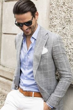 Summer suiting inspiration with white pants brown leather belt blue button up shirt gray and white window pane blazer with a white pocket square black sunglasses Mens Fashion Suits, Mens Suits, Fashion Outfits, Fashion Top, Fashion Wear, Street Fashion, Terno Casual, Blazer Outfits Men, Look Man