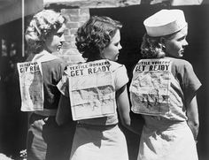 Textile workers displaying picket signs pinned on their backs during Labor Day demonstration in Gastonia, N.C. 1934.