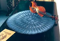 Violin doily! Very nice - although, again, not very naughty.