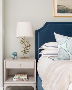 Blue and gray bedroom features a blue velvet bed dressed in white and blue hotel bedding as well as blue lotus pillows flanked by light gray nightstands, Redford House Bennett 1 Drawer Nightstands, topped with gold leaves lamps. Velvet Bed, Blue Velvet, How To Dress A Bed, Bed Lights, Girl Bedroom Designs, Home Decor Bedroom, Gray Bedroom, Master Bedroom, House Beds