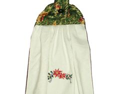 Fabric top is 100% cotton with tab and button for easy hanging. Fabric is green background with angels. On bottom of towel, in center, is an embroidered pointsetta and leaves. Add Christmas to your kitchen with this decorative towel. Everyone will love it!